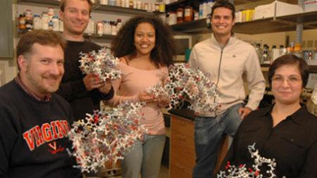 University of Virginia Biomedical Sciences Graduate Program student in lab displaying their work.