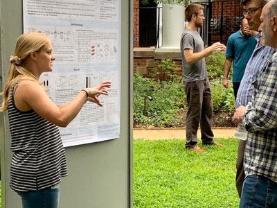 UVA Cell and Molecular Biology grad student talking about her poster.