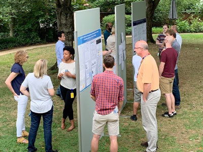 UVA Cell and Molecular Biology posters and people at a poster session held on the grounds of UVA.